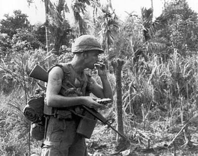 Biting Photograph - Vietnam Pineapple Snack by Underwood Archives