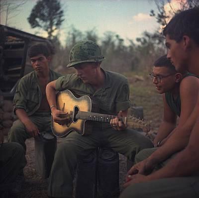 Vietnam War. Us Army Infantrymen Gather Print by Everett