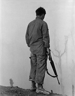 Vietnam War. Us Infantryman Looks Print by Everett