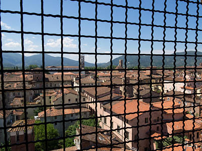 Lucca Photograph - View Of Buildings Through Barred Window by Panoramic Images