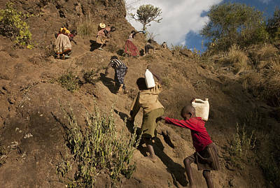 Transportation Of Goods Photograph - Villagers Carrying River Water by Lynn Johnson