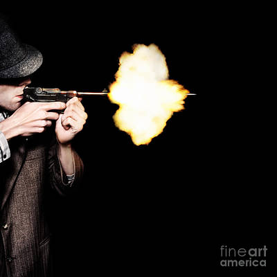Vintage Gangster Man Shooting Gun On Black Print by Jorgo Photography - Wall Art Gallery