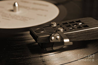 Monochrome Photograph - Vinyl Record Playing On A Turntable In Sepia by Angelo DeVal