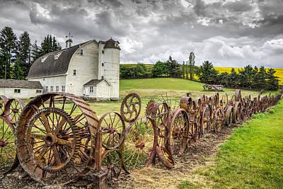 Wagon Wheel Fence At The Dahmen Barn Print by Brad Stinson