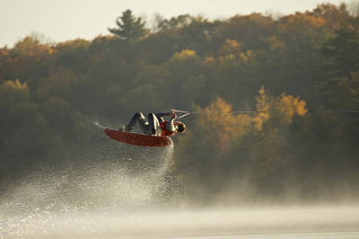 Wakeboarding Photograph - Wakeboarder Jumping In Lake by Lwa