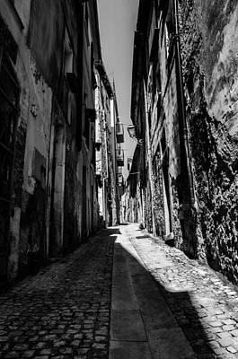 Black And White Photograph - Walking Through The Streets Of Pretoro - Italy  by Andrea Mazzocchetti