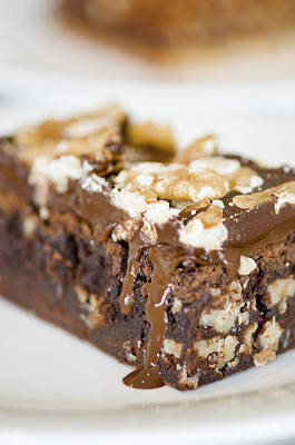 Walnut Brownie On A White Plate Print by Ulrich Schade