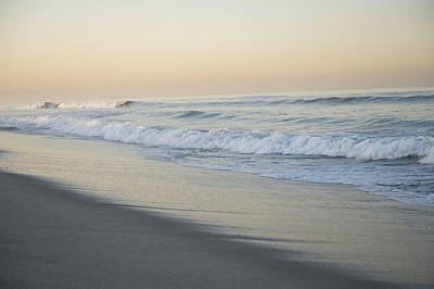 Venice Beach Photograph - Waves Splash Onto A Beach In Venice by Joel Sartore