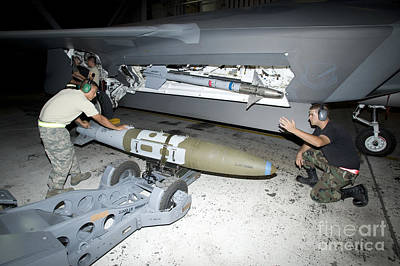 F-22 Photograph - Weapons Loaders Load A Gbu-32 Jdam by HIGH-G Productions