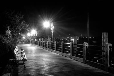 Wilmington Riverwalk At Night In Black And White Print by Greg Mimbs