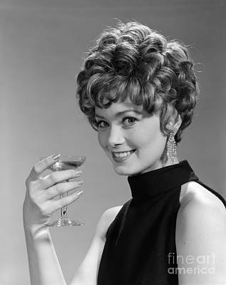Dangle Earrings Photograph - Woman Drinking Champagne, C.1960s by H. Armstrong Roberts/ClassicStock