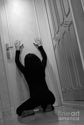 Woman Kneeling In Corridor With Hands On Closed Door Print by Sami Sarkis