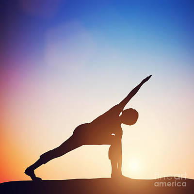 Harmony Photograph - Woman Standing In Revolved Side Angle Yoga Pose Meditating At Sunset by Michal Bednarek