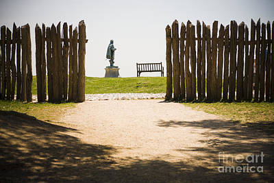 Wooden Fence And Statue Of John Smith Print by Roberto Westbrook