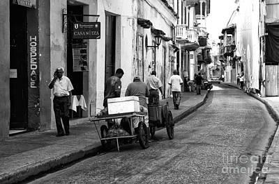 Working In Cartagena Print by John Rizzuto