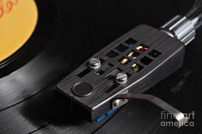 Vintage Photograph - Yellow Label Vinyl Record Playing On A Turntable by Angelo DeVal