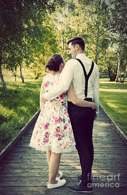 Vintage Photograph - Young Couple Embrace While Standing On Wooden Path by Michal Bednarek
