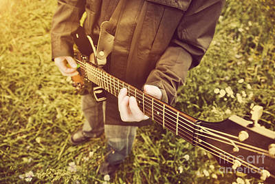 Joy Photograph - Young Man Playing On The Guitar Outdoors by Michal Bednarek