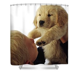 Boy Holding Puppy Up Shower Curtain by Ron Nickel