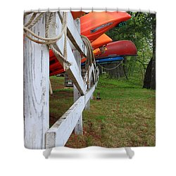 Kayaks On A Fence Shower Curtain by Michael Mooney