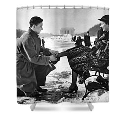 Man Lends A Helping Hand To Put On Skates Shower Curtain by Underwood Archives