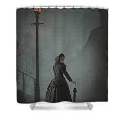 Victorian Woman Under Streetlamp In Fog Shower Curtain by Lee Avison