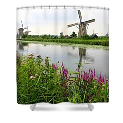 Windmills Of Kinderdijk With Wildflowers Shower Curtain by Carol Groenen