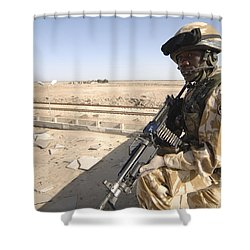 A British Army Soldier Provides Shower Curtain by Andrew Chittock