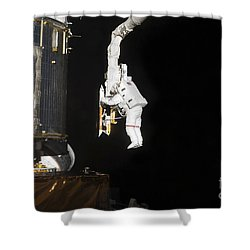 Astronaut Working On The Hubble Space Shower Curtain by Stocktrek Images