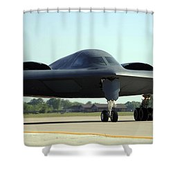 A B-2 Spirit Taxis Onto The Flightline Shower Curtain by Stocktrek Images
