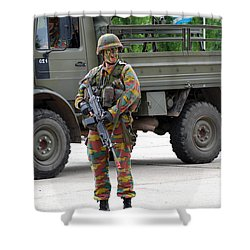 A Belgian Infantry Soldier Handling Shower Curtain by Luc De Jaeger