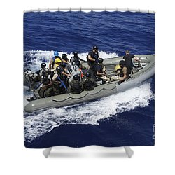 A Rigid-hull Inflatable Boat Carrying Shower Curtain by Stocktrek Images