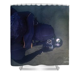An Over The Shoulder View Of A Navy Shower Curtain by Michael Wood