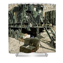 Camouflage Netting Covers A Cargo Truck Shower Curtain by Stocktrek Images
