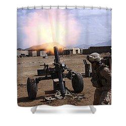 A U.s. Marine Corps Gunner Fires Shower Curtain by Stocktrek Images