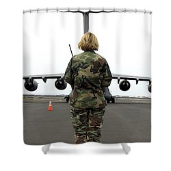 An Airfield Manager Greets An Arriving Shower Curtain by Stocktrek Images