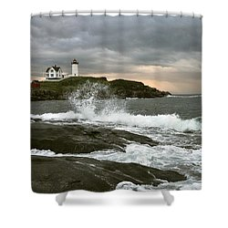 Nubble Light In A Storm Shower Curtain by Rick Frost