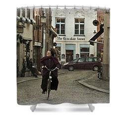 Nun On A Bicycle In Bruges Shower Curtain by Joan Carroll