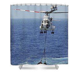 Two Sa-330 Puma Helicopters Deliver Shower Curtain by Stocktrek Images