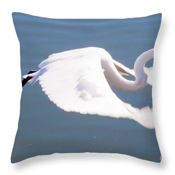 Great Egret In Flight Throw Pillow by Thomas Marchessault