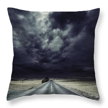 An Asphalt Road With Stormy Sky Above Throw Pillow by Evgeny Kuklev