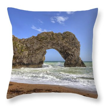 Durdle Door Throw Pillow by Joana Kruse