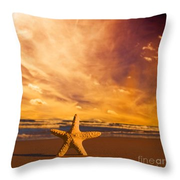 Starfish On The Beach At Sunset Throw Pillow by Michal Bednarek