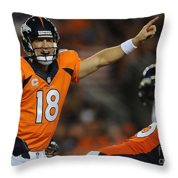 Peyton Manning Throw Pillow by Marvin Blaine