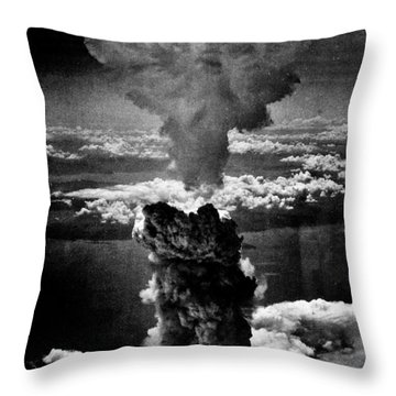 A-bomb Throw Pillow by Benjamin Yeager