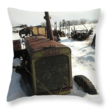 A Tractor In The Snow Throw Pillow by Jeff Swan