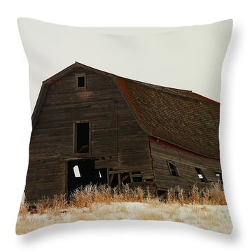 An Old Leaning Barn In North Dakota Throw Pillow by Jeff Swan