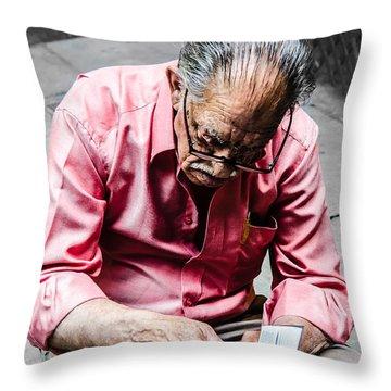 An Old Man Reading His Book Throw Pillow by Sotiris Filippou