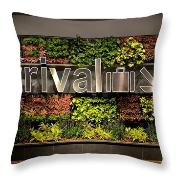 Arrival Sign Arrow And Flowers At Singapore Changi Airport Throw Pillow by Imran Ahmed