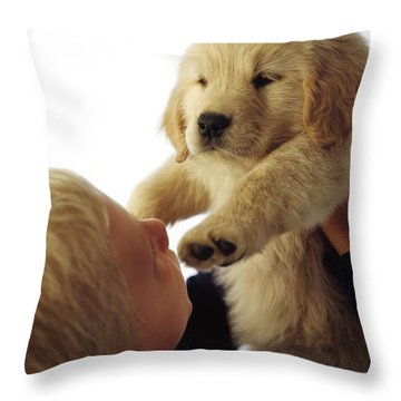 Boy Holding Puppy Up Throw Pillow by Ron Nickel
